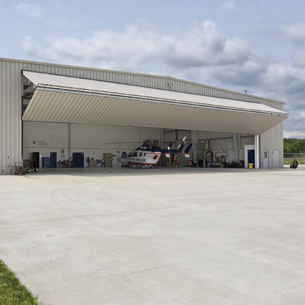 folding hangar door / automatic / for aircraft / for helicopters - PREMIER™ & Folding hangar door / automatic / for aircraft / for helicopters ...