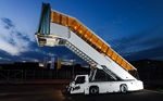 Self-propelled passenger boarding stairs / with escalator / for aircraft RUNWAY2458Cd VIP TIPS D.O.O.