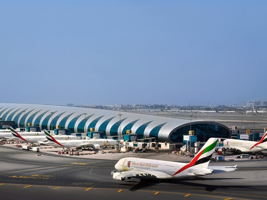 An Emirates A380 (foreground) taxies at a busy Dubai International Airport. (Photo: Emirates)
