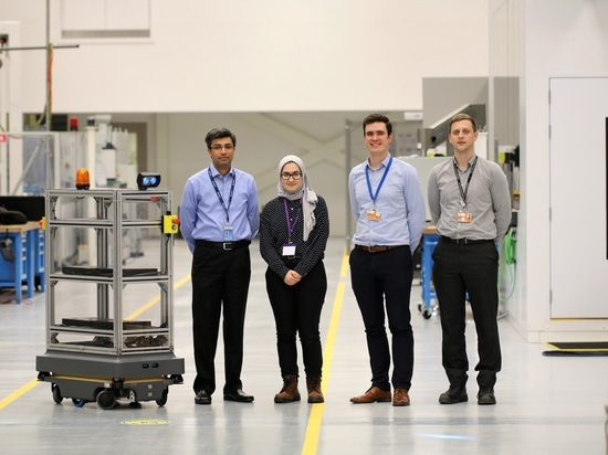 (L-R) Amer Liaqat and Sema Al-Attbi of Airbus UK with Dr Lloyd Tinkler and Dr Scott Dufferwiel of the AMRC and the MiR200 robot shown with its racking, integrated flashing beacon and direction indi...