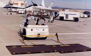 runway sweeper / tractor-mounted / magnetic