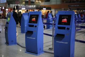 check-in kiosk with passport reader / with printer / with barcode reader / with boarding pass reader