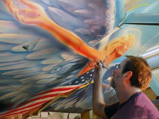 """John Stahr airbrushing details on the """"belly angel"""" of his RV-8 American Angel."""