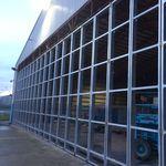 porta per hangar scorrevole / pieghevole / per aereo / per elicottero