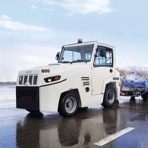 trator rebocador / com barra de reboque / para carrinhos de bagagem / com cabine